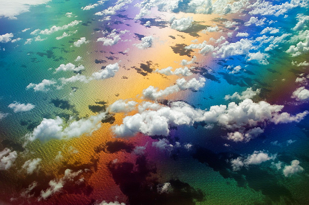 A symphony of color lights up a sunny sky somewhere over the Atlantic Ocean.