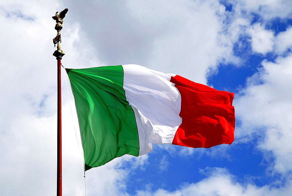 Italian flag at the National monument at the Piazza Venezia in Rome