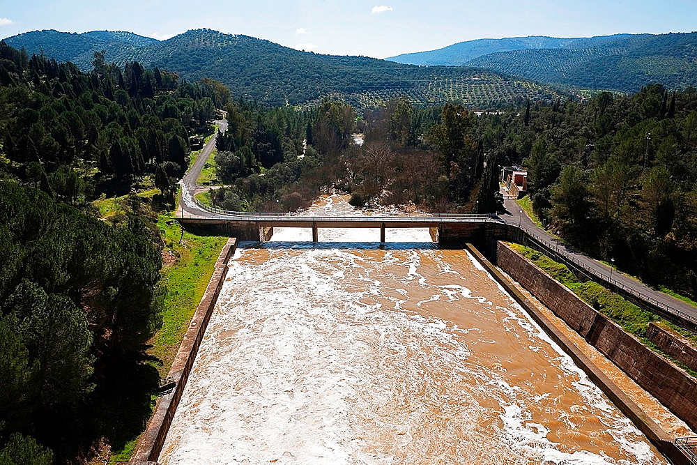 Expulsion of water after heavy rains in the reservoir of Puente Nuevo to river Guadiato, near Cordoba, Andalusia, Spain