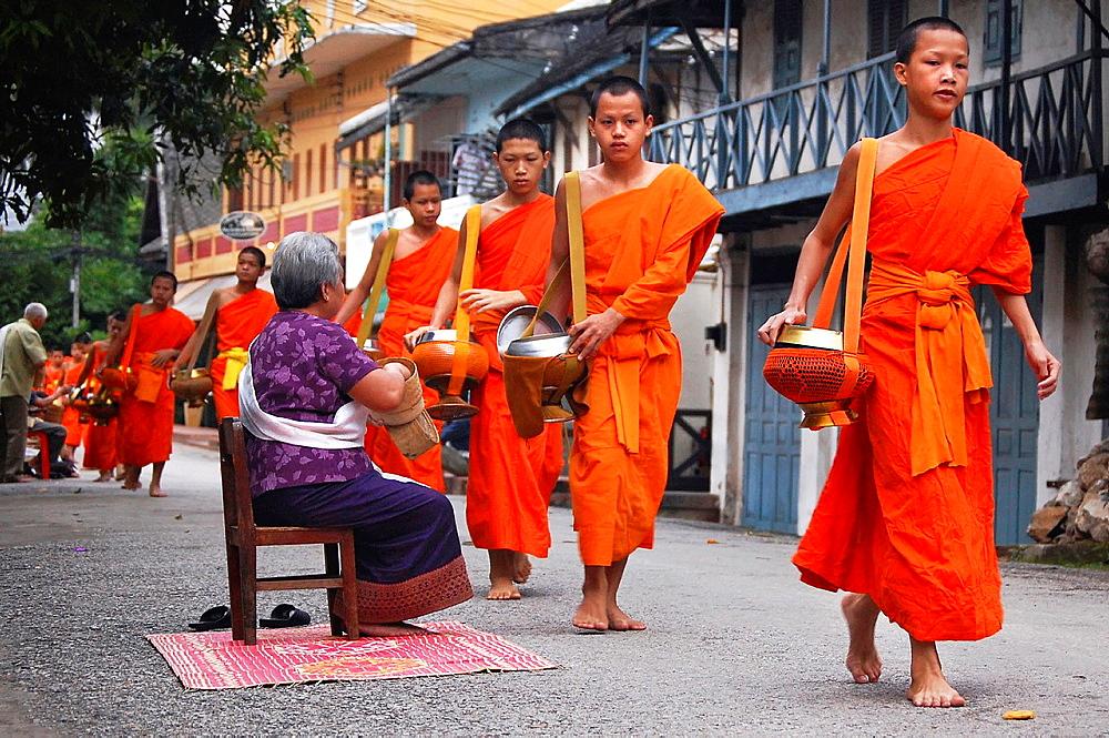 Early morning alms giving to the monks in Luang Prabang. Laos, Luang Prabang.
