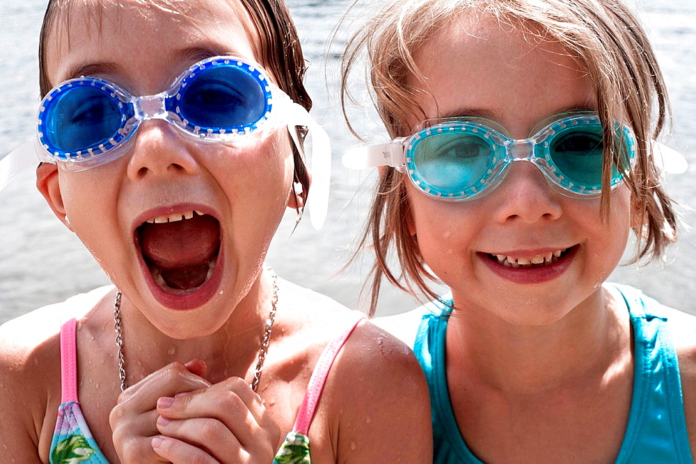 Two girls wearing swimming goggles - 817-442677