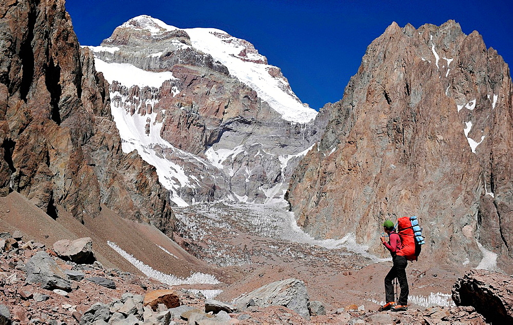 Woman looks at the East Face of Aconcagua in the Andes Mountains, Mendoza Province, Argentina