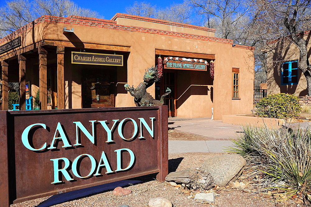 The Canyon Road sign with a gallery in the background. Santa Fe. New Mexico. USA.