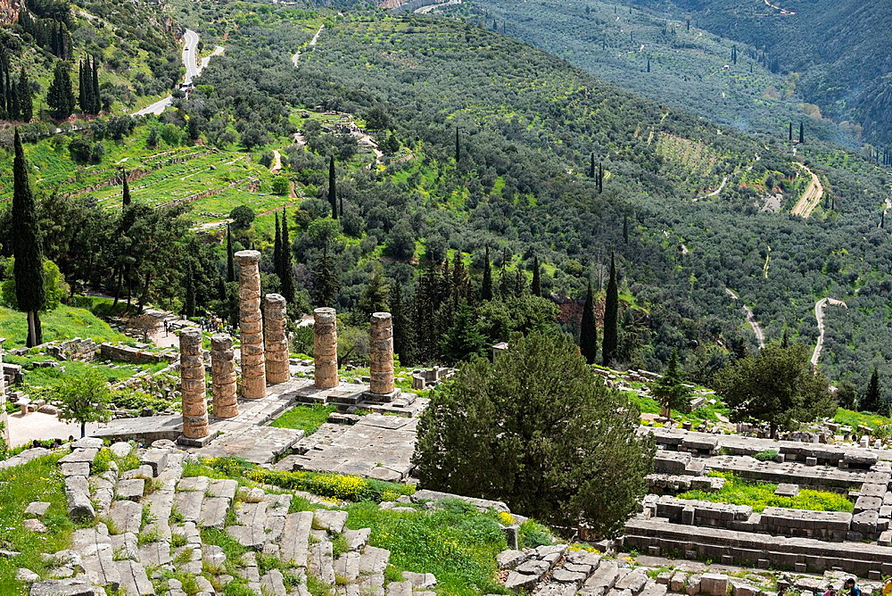 Looking down on the Temple of Apollo and the theater at the ancient site of Delphi in Thessaly, Central Greece.