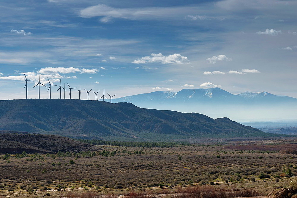 Windmills at Tudela road to Ejea de los Caballeros, with Moncayo Pic background. Navarre, Spain.