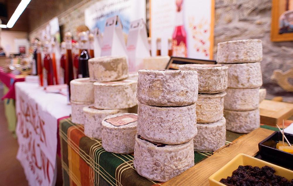 Cheese stacked at Ferieta de Ainsa 2013, Sobrarbe-Huesca, Aragon Pyrenees, Spain.