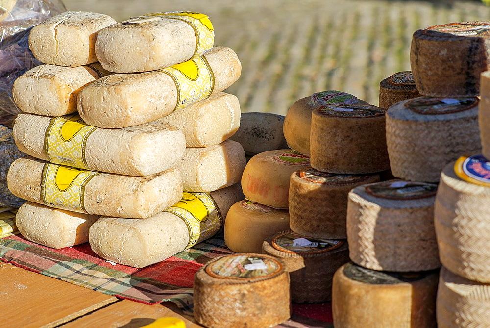 Cheese staked at Mediaeval village of Ainsa during 2013 Ferieta Celebration, Sobrarbe-Huesca, Aragon Pyrenees, Spain.