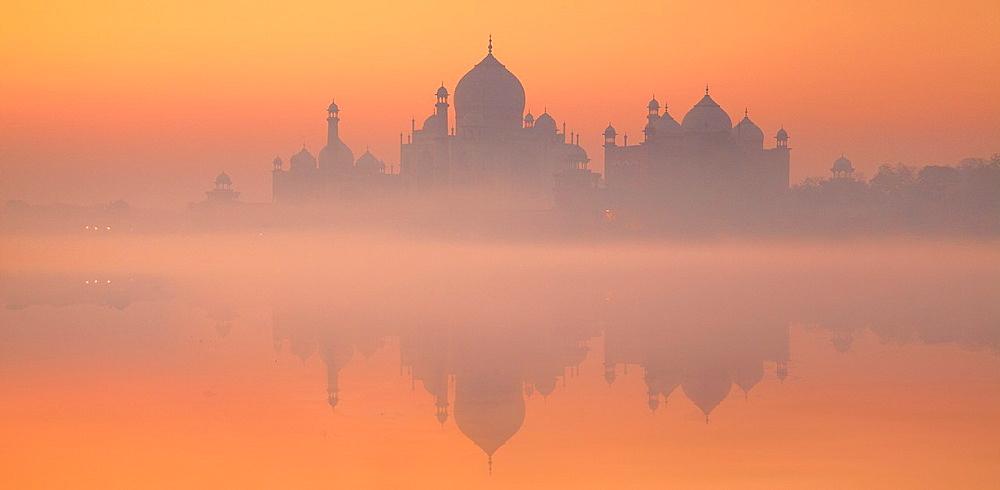 Taj Mahal with reflexion of Taj Mahal in Yamuna River, Agra, Uttar Pradesh, India.