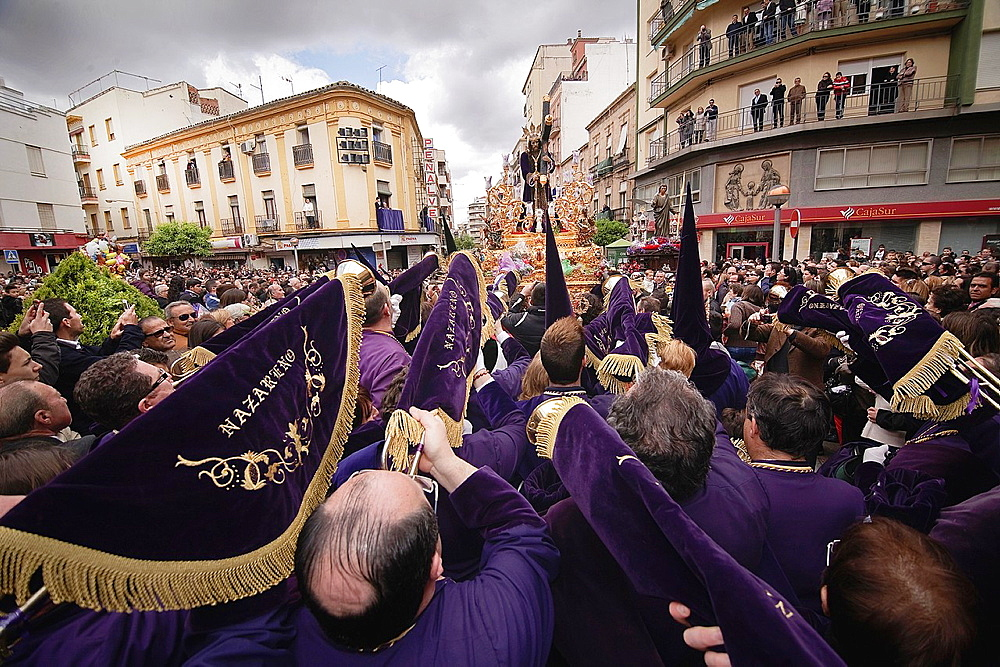 Penitents to playing their trumpets in a Holy week procession to the Nazarene, Holy Friday, Linares, Jaen province, Spain.