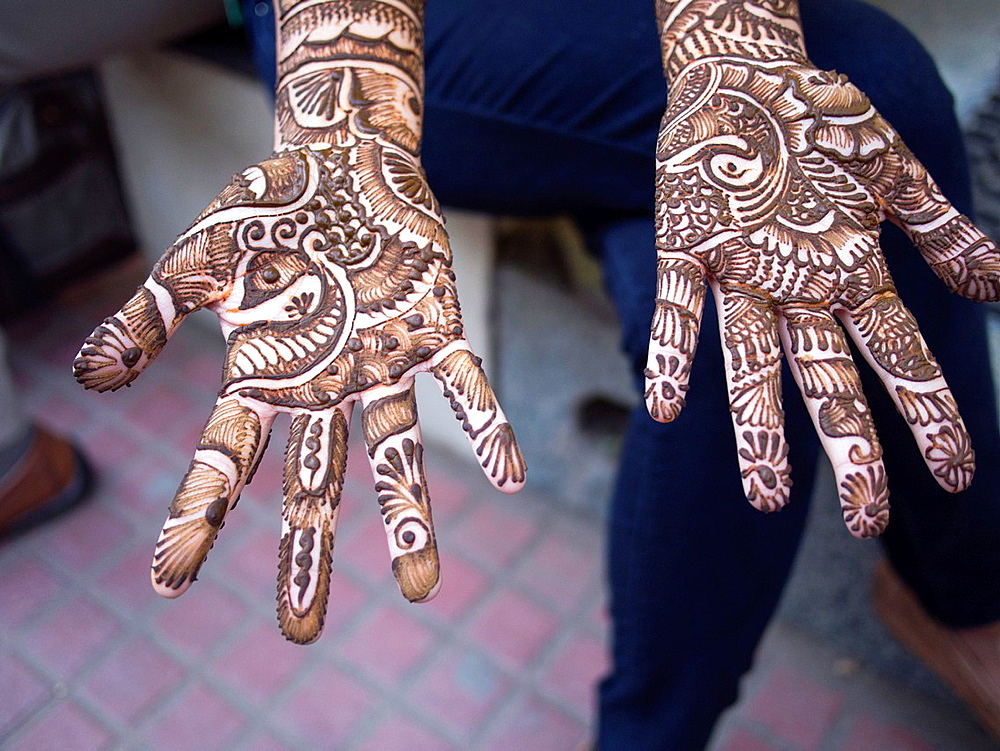 A young womans hands are completely covered in henna in Bangalore, Karnataka, India.