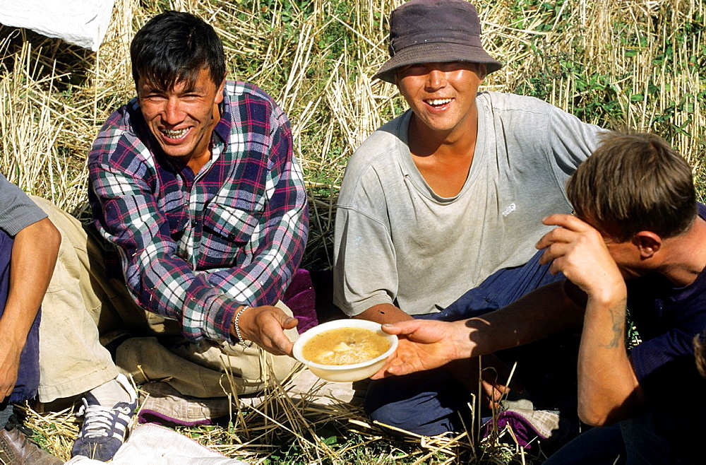 Issyk Kul Lake, Field Worker have lunch, Kyrgyzstan.