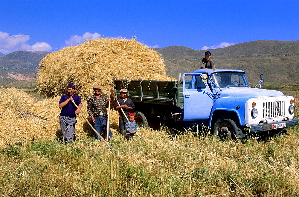 Issyk Kul Lake, field worker, Hay Harvest, russian Truck, Kyrgyzstan.