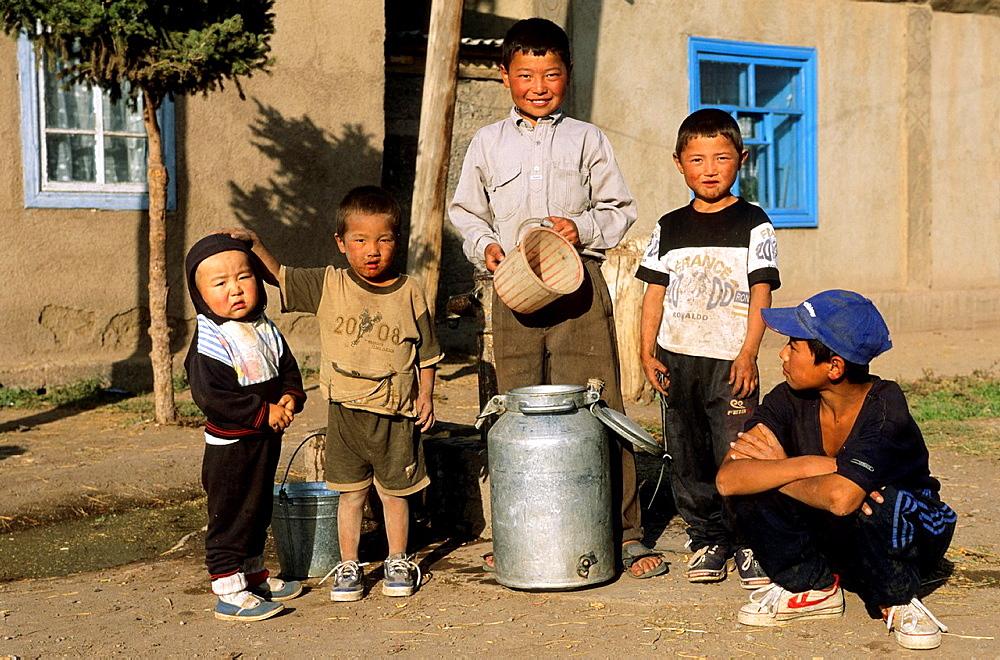 Local People and Kids, Issyk Kul Lake, Kyrgyzstan, milk jug, poor people.