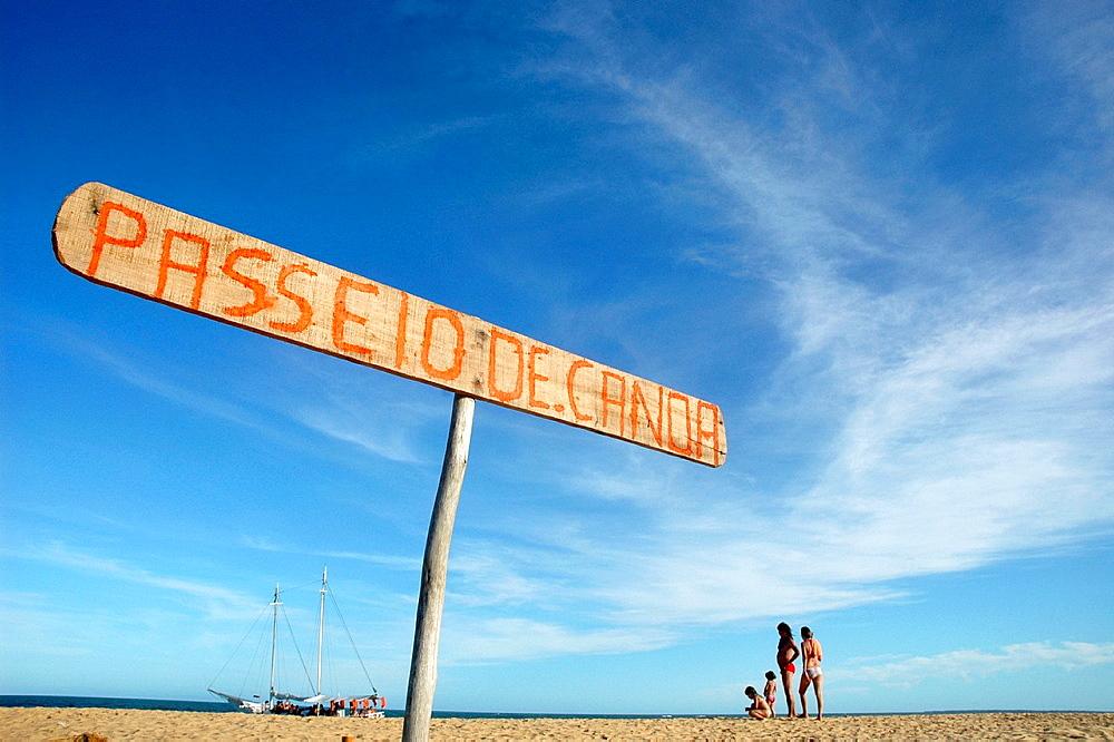 Caraiva, Bahia, Brazil, sign offering canoe tours at the beach