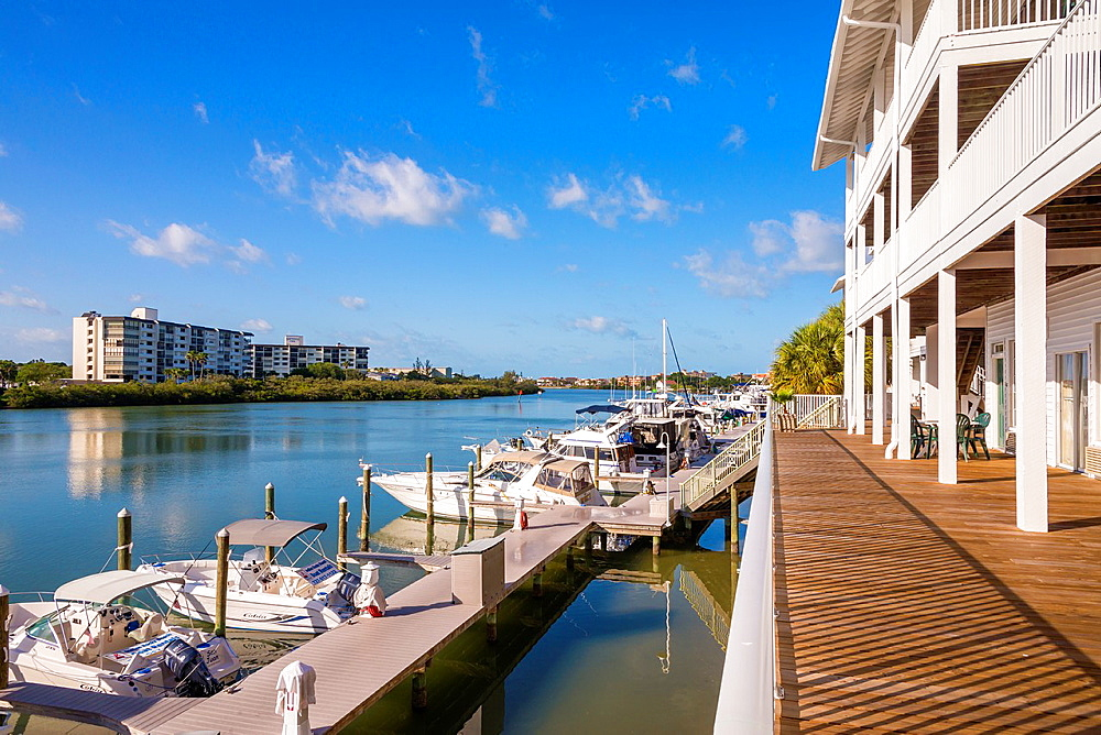 Holiday Inn Hotel with deck and boat rental station, Indian Rocks Beach, Florida, USA.