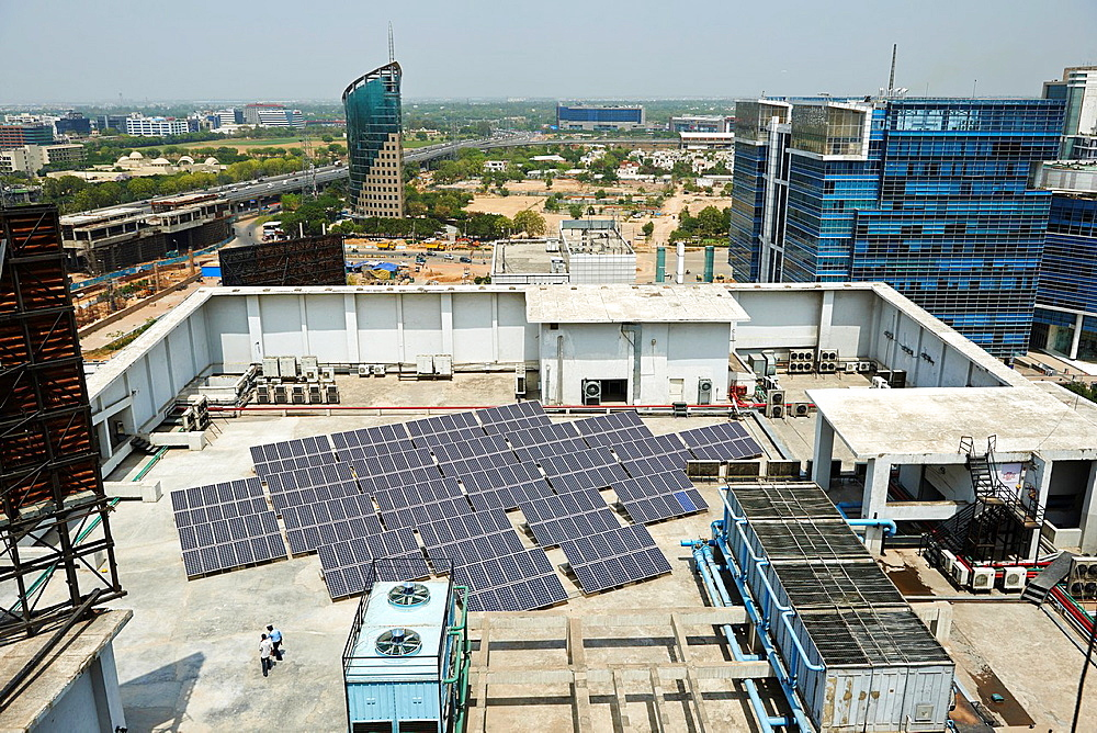 An array of solar panels on top of a building in Delhi.