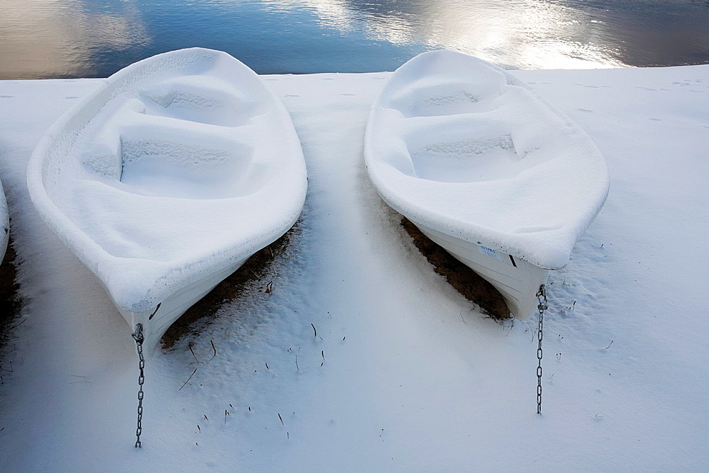 rowboats covered in snow, Finland.
