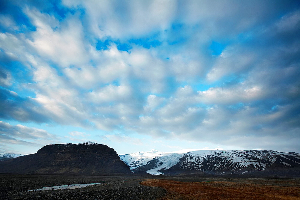 Cirrus clouds over glacier, Vatnajokull Ice Cap, Iceland.