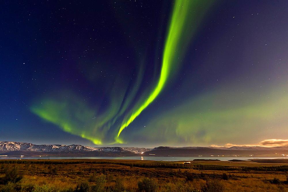 Aurora Borealis over farm in Eyjafjordur, Northern Iceland.