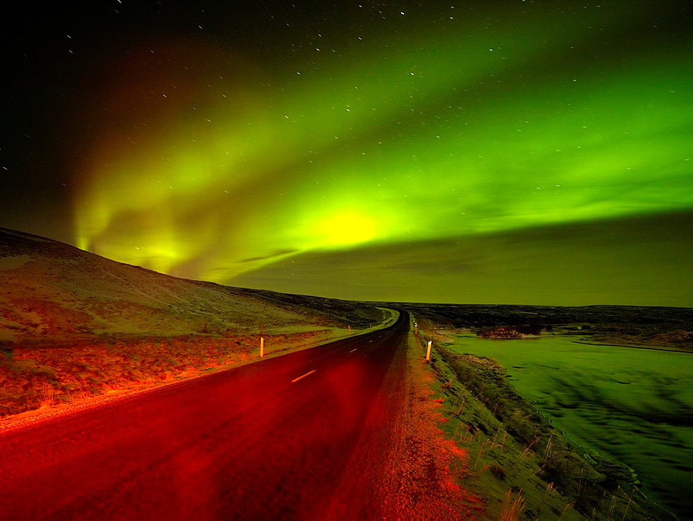 Aurora Borealis over empty road, Iceland.