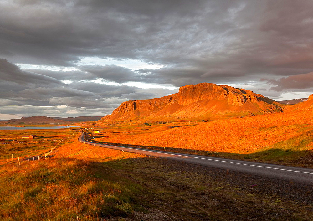 Sunset over road and landscape, Borgarfjordur, Iceland.
