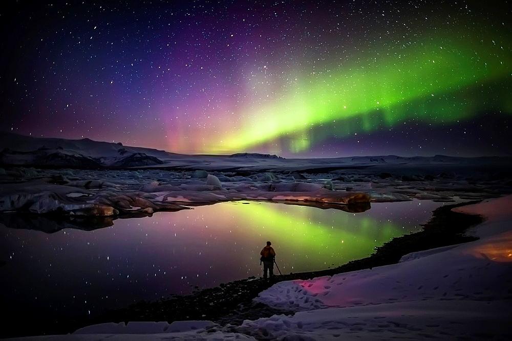 Taking pictures of the Northern Lights at the Jokulsarlon, Breidarmerkurjokull, Vatnajokull Ice Cap, Iceland.