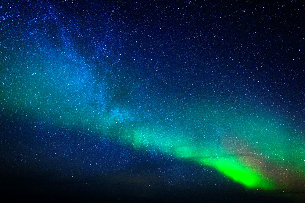 Aurora Borealis or Northern lights with the Milky way, Iceland.