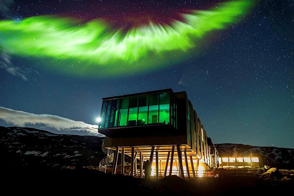 Aurora borealis over Hotel ION, located by Nesjavellir Power Plant, Iceland.