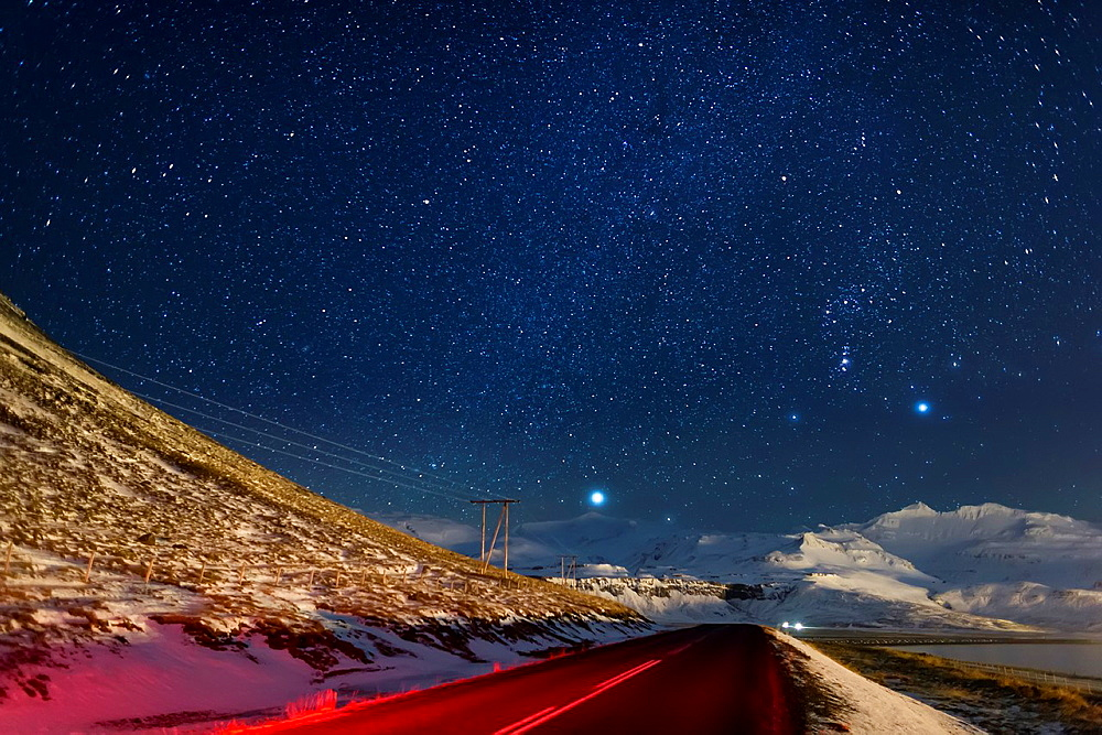 Starry night-Milky Way galaxy with empty road and power lines, Grundarfjordur, Snaefellsnes Peninsula, Iceland.