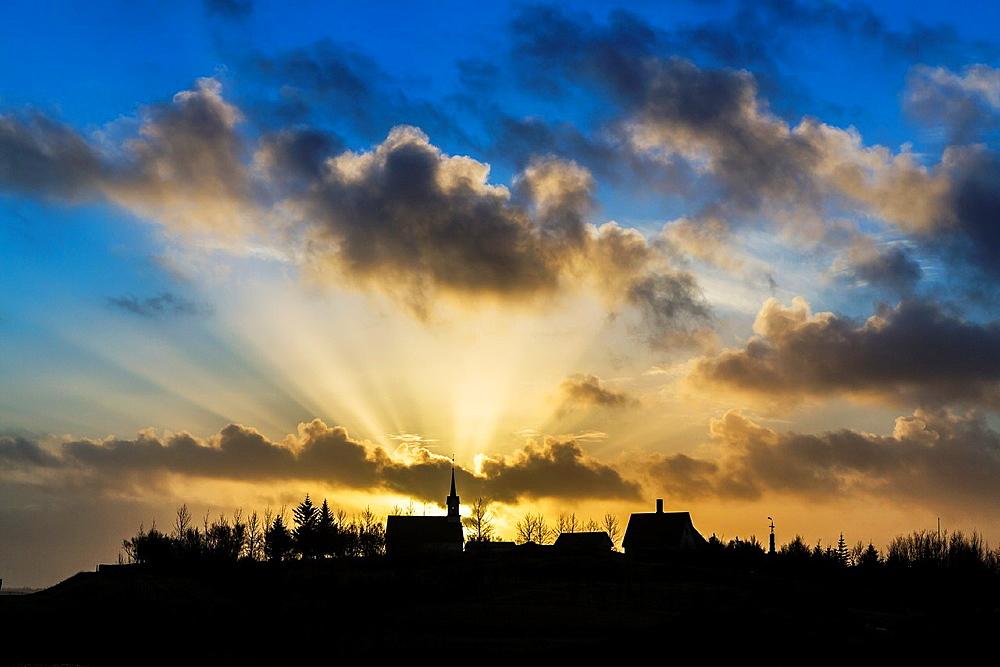 God rays over a church named Kotstrandarkirkja, Snaefellsnes Peninsula, Iceland.