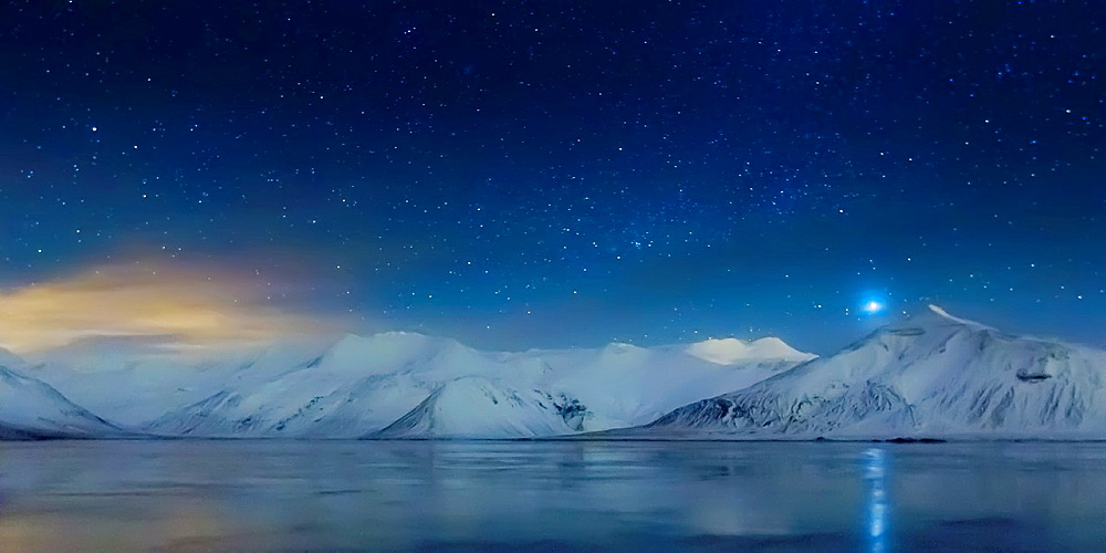 Starry night-Milky Way, over snow covered landscape.
