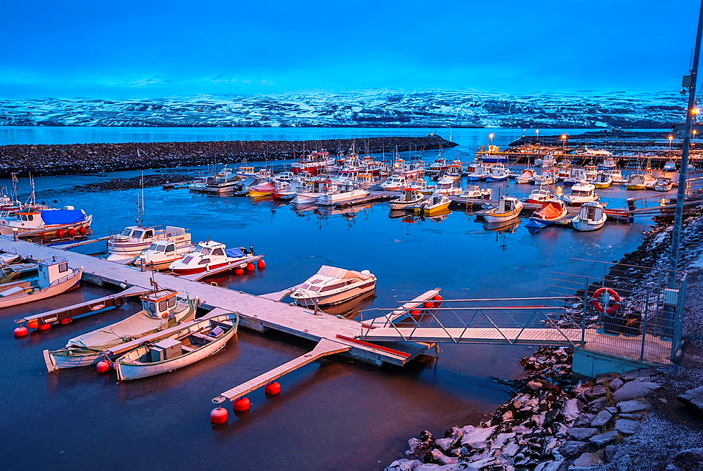 Small boats in the harbor, winter, Akureyri, Iceland.