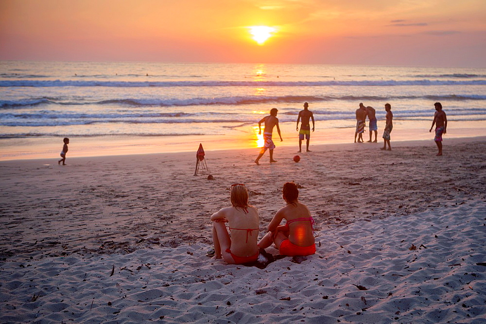Locals and visitors gather at Santa Teresa beach to watch the sunset, Costa Rica.
