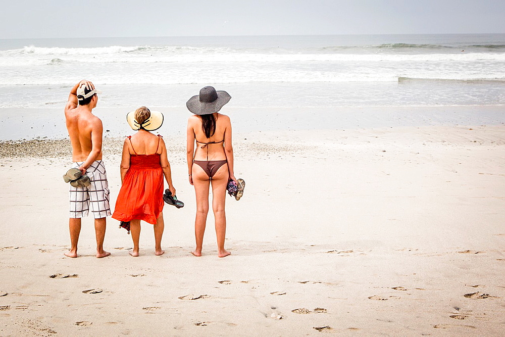 Family looking at surf, Playa Carmen, Costa Rica.