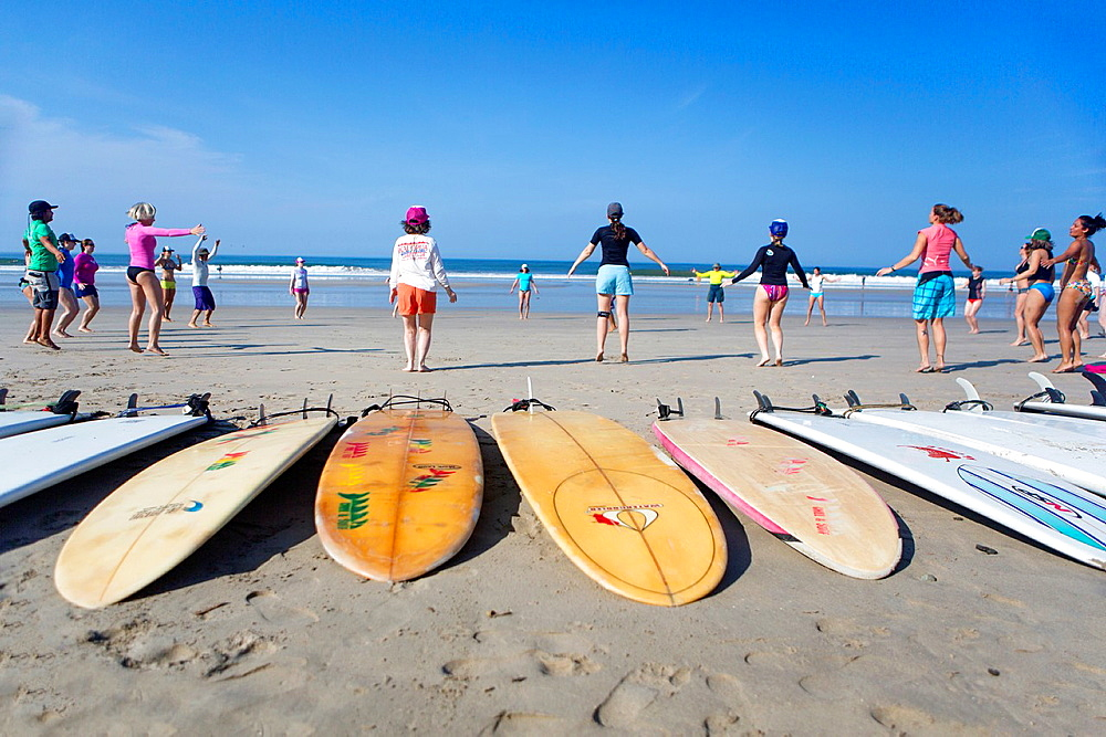 Warming up for a surf lesson, Santa Teresa beach, Costa Rica.