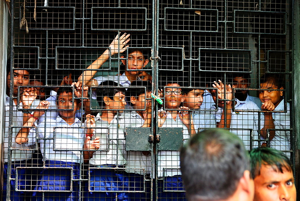 Pupils behind bars, College Street, Kolkata, India.