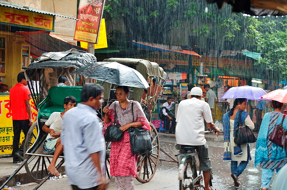 People walking under the rain, College Street, Kolkata, India.