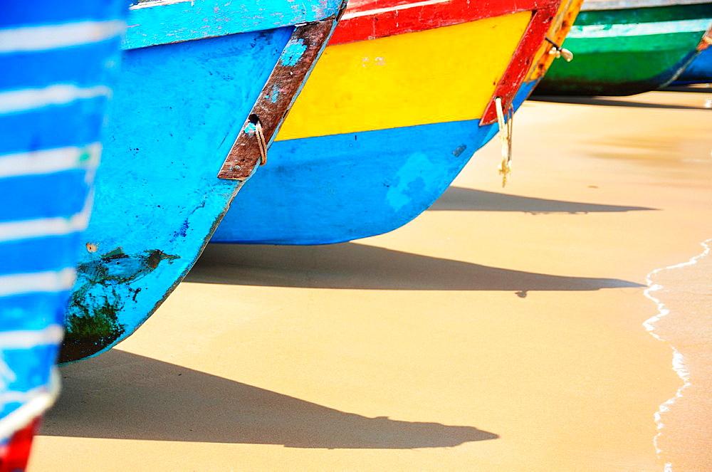 Colourful fishing boats on beach, Vizhinjam village, Kovalam, Kerala, India.