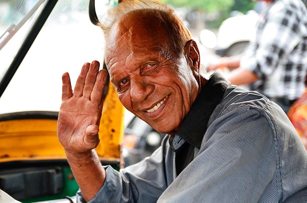 Auto rickshaw driver, Delhi, India.