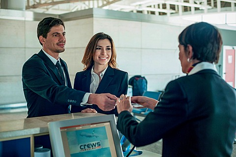 Businesspeople at airport check in area