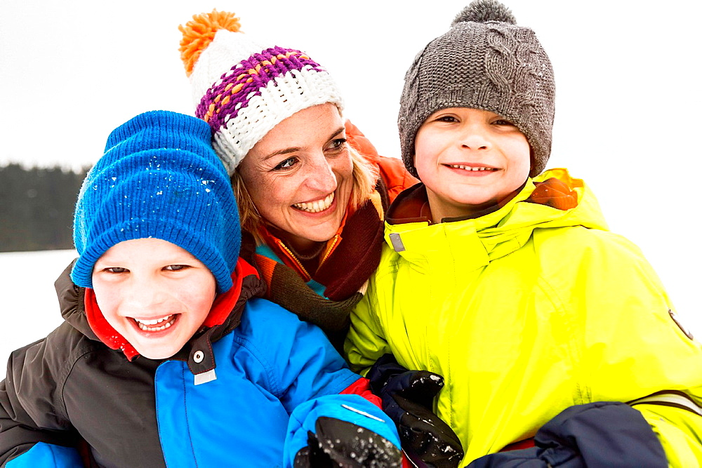 Mother with two boys wearing knit hats