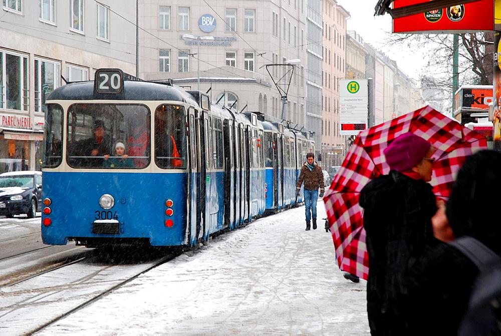 Old tram on a snowy winter day in Munich.