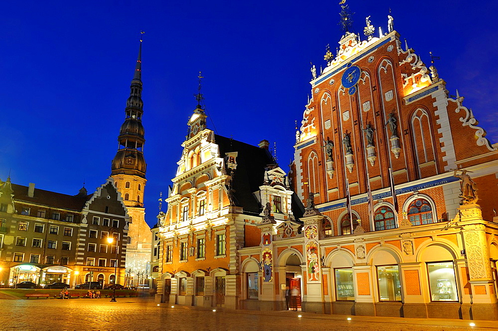St Peter's Church, House of the Blackheads and Schwabe House, City Hall Square by night, Ratslaukums, Riga, Latvia, Baltic region, Northern Europe.
