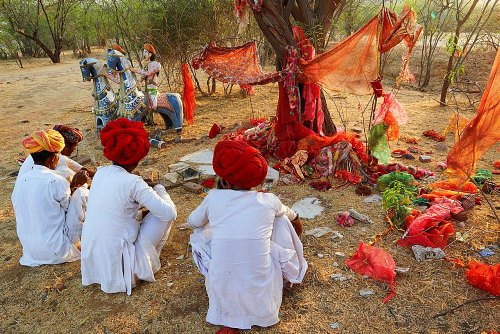 India, Rajasthan, Meda village around Jodhpur, Rabari ethnic group, prayer at Mata Mandir (Mother temple).