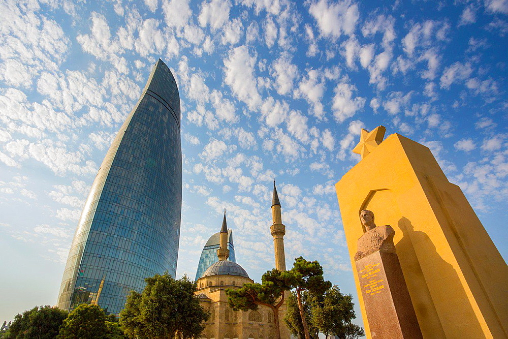 Azerbaijan, Baku City,Monument to H. Aslanov at Shadhidlar Hiyabani and Flame Tower.