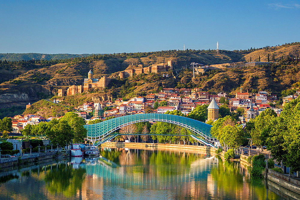 Georgia, Tbilisi City,The Peace Bridge and Narikala Castle.