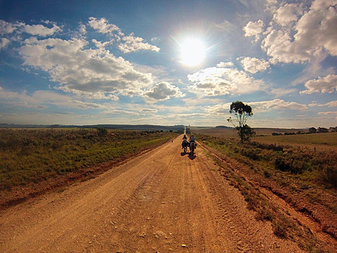 Senior man riding horse on dirt track, Uruguay