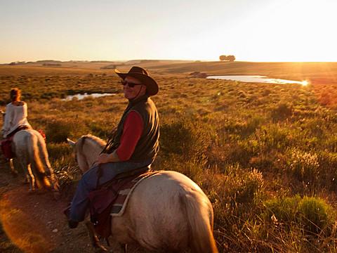 Senior man riding a Criollo horse, Uruguay