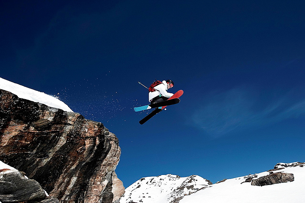 Low angle view of male skier mid air