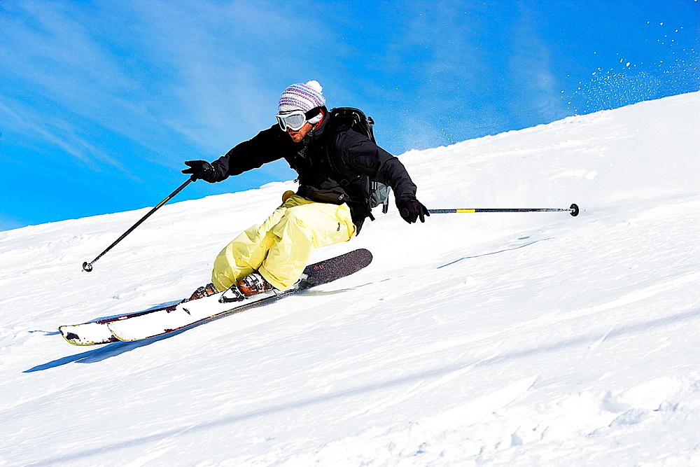 Male skiing down mountain
